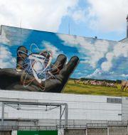 Muralmålning vid entrén till Tjernobyl. Efrem Lukatsky / TT NYHETSBYRÅN