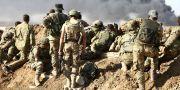 Turkiska styrkor tillsammans med syriska rebeller i Syrien i oktober. NAZEER AL-KHATIB / AFP