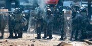 Hongkong-poliser. Ng Han Guan / TT NYHETSBYRÅN