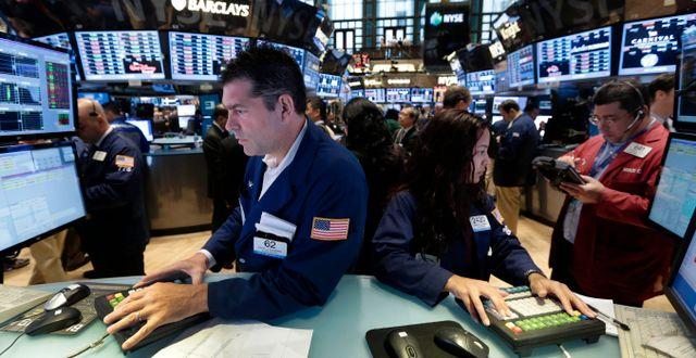 Illustrationsbild. Börsmäklare på Wall Street. Richard Drew / TT NYHETSBYRÅN