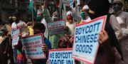 Antikinesiska protester i Indien. Rafiq Maqbool / TT NYHETSBYRÅN