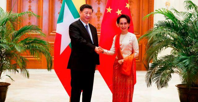 Kinas ledare Xi och Myanmars statskansler Aung San Suu Kyi. NYEIN CHAN NAING / POOL