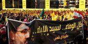 Hizbollah-supportrar i Beirut.  Hussein Malla / TT NYHETSBYRÅN