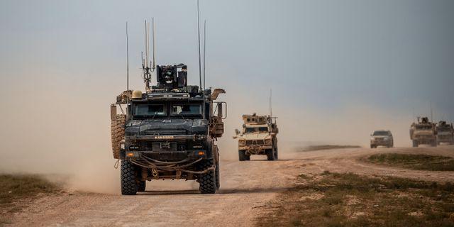 Bilden är tagen igår och visar fordon som tillhör USA-stödda koalitionen. Det är inte den aktuella bilen på bilden som är i texten.  BULENT KILIC / AFP