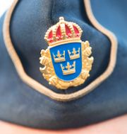 En person med polismässa. Arkivbild.  FREDRIK SANDBERG / TT / TT NYHETSBYRÅN