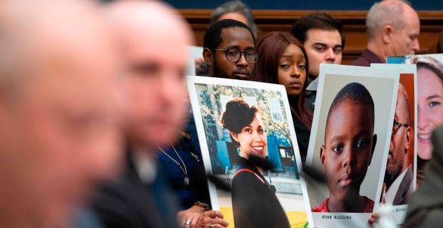 Anhöriga till offren vid dagens utfrågning. JIM WATSON / AFP