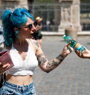 Utdelning av vattenflaskor i Rom. Cecilia Fabiano / TT NYHETSBYRÅN
