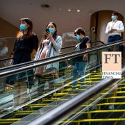 People wearing face masks to protect against the coronavirus ride escalators at a shopping mall in Beijing, Friday, Aug. 14, 2020. TT