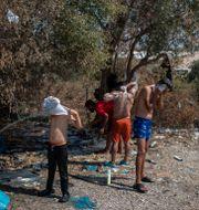 Barn i Morialägret efter branden. Petros Giannakouris / TT NYHETSBYRÅN