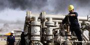 Irakiska oljearbetare.  TT