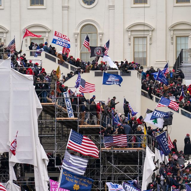 In this Jan. 6, 2021, file photo rioters loyal to President Donald Trump storm the U.S. Capitol in Washington. Arguments begin Tuesday, Feb. 9, in the impeachment trial of Donald Trump on allegations that he incited the violent mob that stormed the U.S. Capitol on Jan. 6. John Minchillo / TT NYHETSBYRÅN