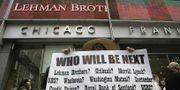 September 2008: Kvinna protesterar utanför Lehman Brothers huvudkvarter i New York. TT
