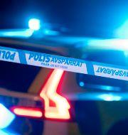 Polisbil med blåljus.  Johan Nilsson/TT / TT NYHETSBYRÅN