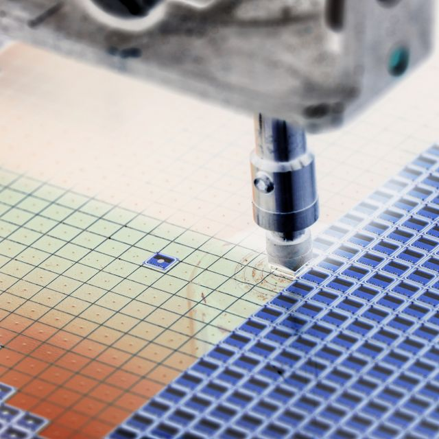 Silicon wafer negative color in machine in semiconductor manufacturing Shutterstock