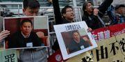Demonstranter till stöd för människorättsaktivisten Xu Zhiyong som gripits av polisen. Vincent Yu / TT NYHETSBYRÅN