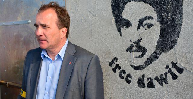 Statsminister Stefan Löfven (S) och Isaaks ansikte avmålat.  HENRIK MONTGOMERY / TT / TT NYHETSBYRÅN