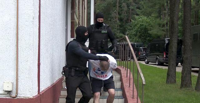 En av de män som greps av belarusiska KGB. TT NYHETSBYRÅN