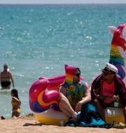 Arkivbild. Turister på en strand på Mallorca.  Francisco Ubilla / TT NYHETSBYRÅN