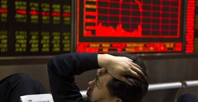 Handlare på Shanghaibörsen. Arkiv. TT