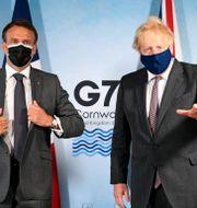 Frankrikes president Emanuel Macron och Storbritanniens premiärminister Boris Johnson.  Stefan Rousseau / TT NYHETSBYRÅN