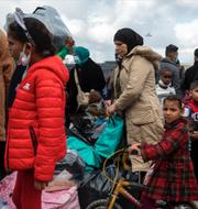 Flyktingar i hamnen Lavrio, söder om Aten / Muren vid gränsen mot Turkiet TT