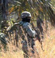 Soldat från en fredsbevarande styrka i Moçambique. Tsvangirayi Mukwazhi / TT NYHETSBYRÅN