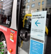Virusuppmaning på SL-buss.  Jessica Gow/TT / TT NYHETSBYRÅN