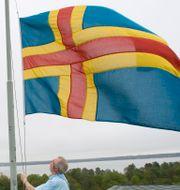 Ålands flagga.  Fredrik Sandberg / TT / TT NYHETSBYRÅN