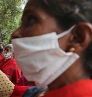 Illustrationsbild. Indiska hushållsarbetare i protest i somras.  Aijaz Rahi / TT NYHETSBYRÅN