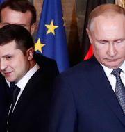 Volodymyr Zelenskyj och Vladimir Putin. IAN LANGSDON / POOL