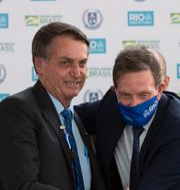 President Jair Bolsonaro tillsammans med Marceollo Crivella.  Silvia Izquierdo / TT NYHETSBYRÅN