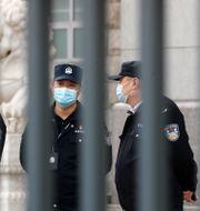 Kinesiska poliser. Andy Wong / TT NYHETSBYRÅN