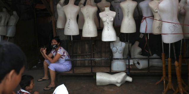 Stängd klädmarknad i Jakarta.  Dita Alangkara / TT NYHETSBYRÅN