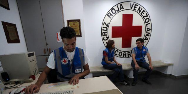 Anställda på Röda Korsets i Caracas. IVAN ALVARADO / TT NYHETSBYRÅN