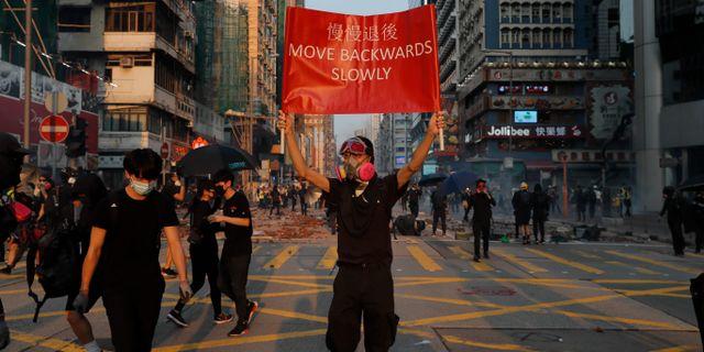 En av många demonstranter i Hongkong. Kin Cheung / TT NYHETSBYRÅN