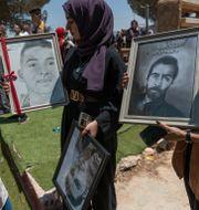 En minnesstund för två offer hölls på Västbanken under tisdagen.  Nasser Nasser / TT NYHETSBYRÅN