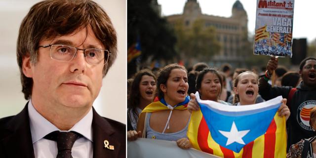 Carles Puigdemont och protest i Barcelona.  TT/AP