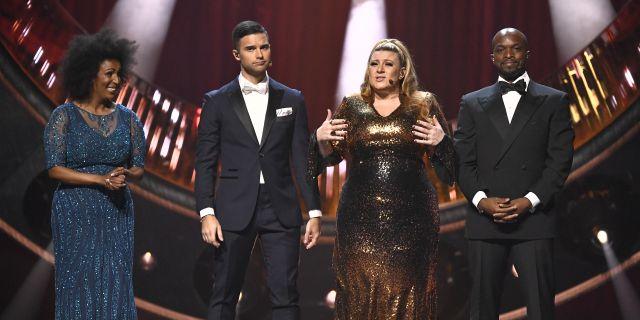 Programledarna i årets Melodifestivalen: Marika Carlsson, Eric Saade, Sarah Dawn Finer och Kodjo Akolor. Claudio Bresciani/TT / TT NYHETSBYRÅN