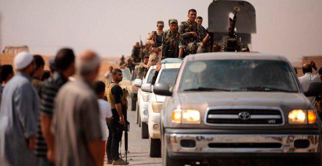 Syriska trupper i staden Ein Issa i Syrien.  TT NYHETSBYRÅN