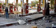En totaltförstörd mack i Iran. - / AFP
