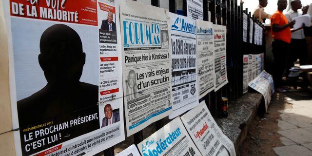 """Tidning med rubriken """"Han är nästa president"""" i Kinshasa på onsdagen. BAZ RATNER / TT NYHETSBYRÅN"""