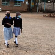 Two girls walk inside a school compound on the first day of reopening at Moi Avenue Primary School, in Nariobi, Kenya, Monday, Jan. 4, 2021 Stringer / TT NYHETSBYRÅN