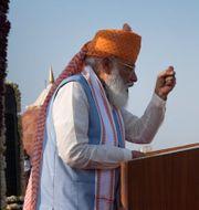 Narendra Modi, till vänster. TT