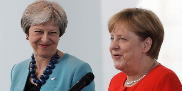 Theresa May och Angela Merkel  Markus Schreiber / TT NYHETSBYRÅN/ NTB Scanpix