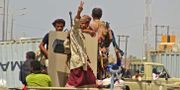 Regeringstrogna styrkor i utkanten av Hodeida. STRINGER / AFP