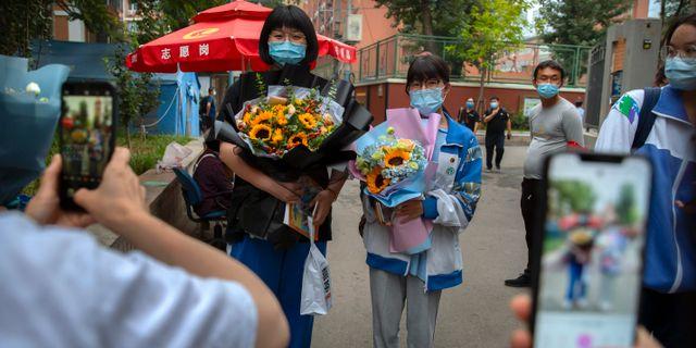 Studenter i Peking. Mark Schiefelbein / TT NYHETSBYRÅN