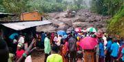 Räddningsarbete efter en liknande översvämning i samma område förra året. TT NYHETSBYRÅN