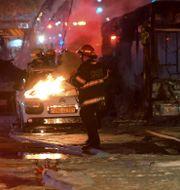 Bilbrand i Holon, nära Tel Aviv, orsakad av en raket från Gaza Avshalom Sassoni / TT NYHETSBYRÅN