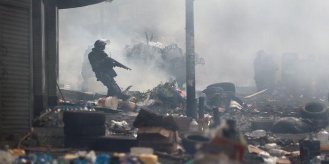 Beväpnad militär har sats in för att återställa ordningen. IVAN ALVARADO / TT NYHETSBYRÅN