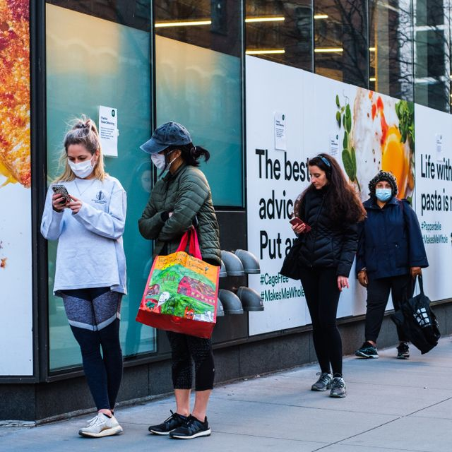 NEW YORK, NEW YORK - APRIL 01, 2020: A long line outside of Whole Foods in Tribeca, New York as the store has implemented social distancing measures during the COVID-19 Shutterstock